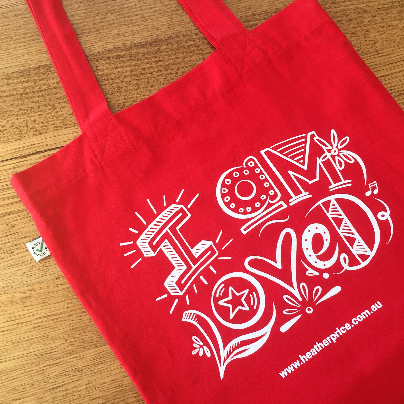 Screen printed album design tote bag with 'I am Loved' text design